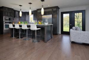Grey kitchen featuring Greystone color hardwood floor (Maple-Greystone) For more information, visit www.miragefloors.com